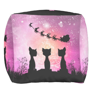 Cats looks to the sky to Santa Claus Pouf