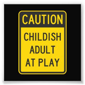 Caution Childish Adult at Play Photographic Print