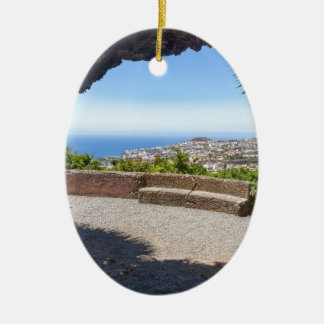 Cave outlook on sea and village on Madeira Ceramic Ornament