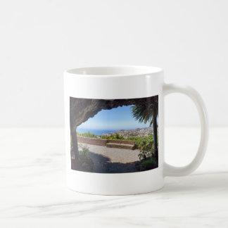 Cave outlook on sea and village on Madeira Coffee Mug