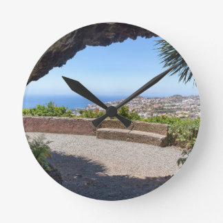 Cave outlook on sea and village on Madeira Round Clock