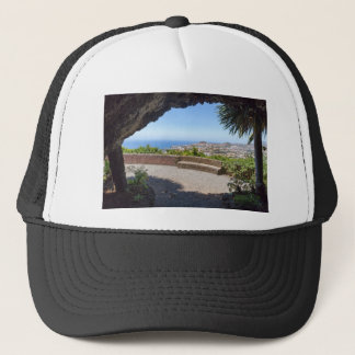 Cave outlook on sea and village on Madeira Trucker Hat