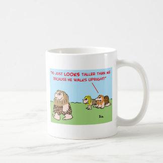caveman taller walks upright coffee mugs