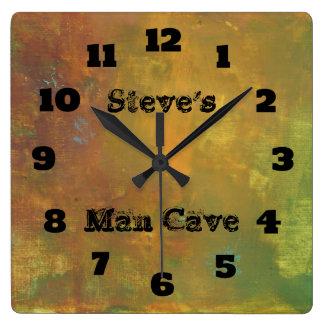 Caverne abstraite d'homme de tons terreux horloge carrée