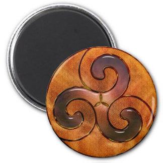 celtic triskele on gold magnet
