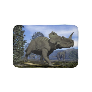 Centrosaurus dinosaurs walking among magnolia tree bath mat