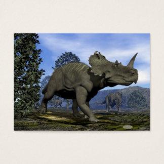 Centrosaurus dinosaurs walking among magnolia tree business card