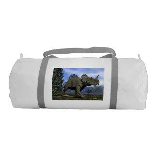 Centrosaurus dinosaurs walking among magnolia tree gym bag