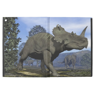 "Centrosaurus dinosaurs walking among magnolia tree iPad pro 12.9"" case"