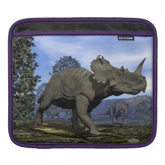 Centrosaurus dinosaurs walking among magnolia tree iPad sleeve