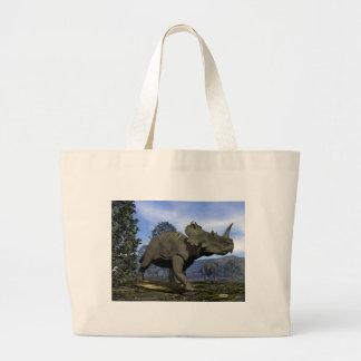 Centrosaurus dinosaurs walking among magnolia tree large tote bag