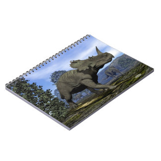 Centrosaurus dinosaurs walking among magnolia tree notebook