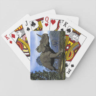 Centrosaurus dinosaurs walking among magnolia tree playing cards