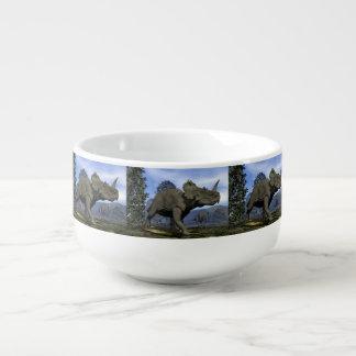 Centrosaurus dinosaurs walking among magnolia tree soup mug