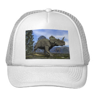 Centrosaurus dinosaurs walking among magnolia tree trucker hat