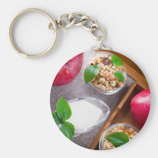Cereal with walnuts and raisins, yogurt and apples basic round button keychain