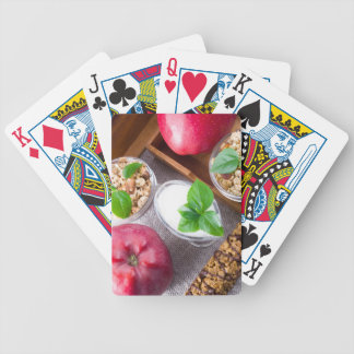 Cereal with walnuts and raisins, yogurt and apples bicycle playing cards
