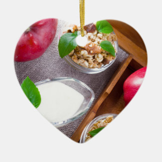Cereal with walnuts and raisins, yogurt and apples ceramic heart ornament