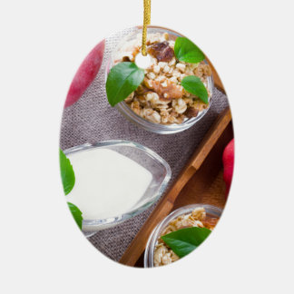 Cereal with walnuts and raisins, yogurt and apples ceramic oval ornament