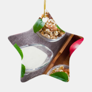 Cereal with walnuts and raisins, yogurt and apples ceramic star ornament