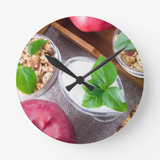 Cereal with walnuts and raisins, yogurt and apples clock