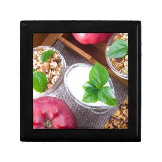 Cereal with walnuts and raisins, yogurt and apples gift box