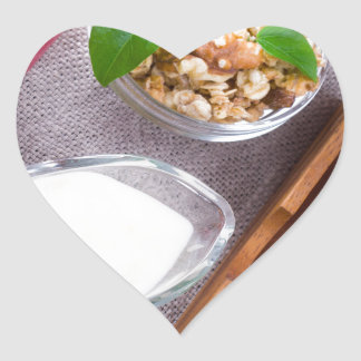 Cereal with walnuts and raisins, yogurt and apples heart sticker