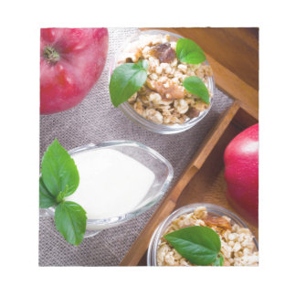 Cereal with walnuts and raisins, yogurt and apples notepad