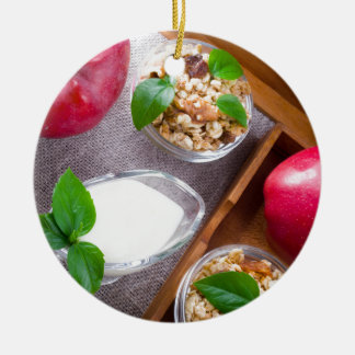 Cereal with walnuts and raisins, yogurt and apples round ceramic ornament