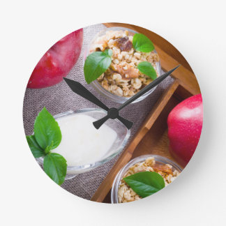 Cereal with walnuts and raisins, yogurt and apples round clock