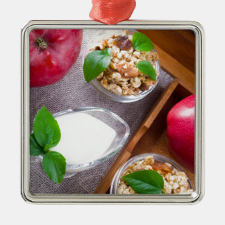 Cereal with walnuts and raisins, yogurt and apples Silver-Colored square ornament