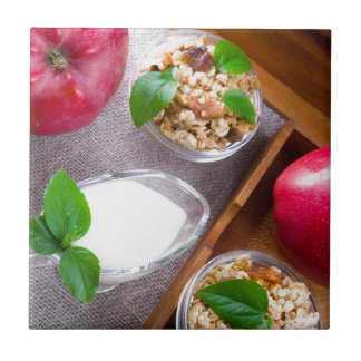 Cereal with walnuts and raisins, yogurt and apples tile