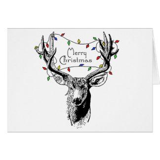 Cerfs communs avec des lumières de Noël Carte