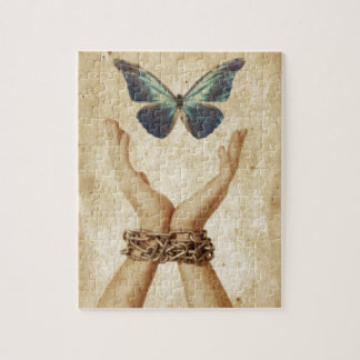 Chained Hand With Butterfly Hovering Above Jigsaw Puzzle