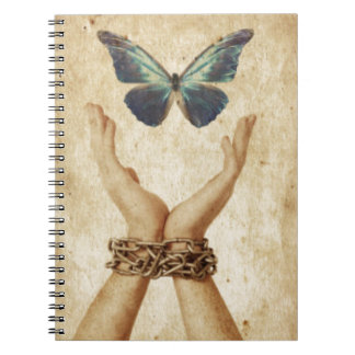 Chained Hand With Butterfly Hovering Above Notebooks