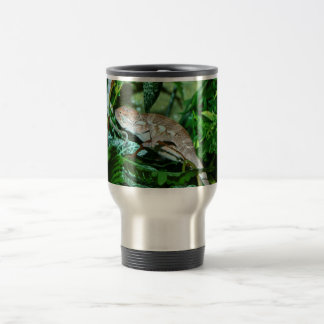 Chameleon changing in green environment travel mug