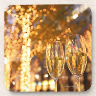 Champagne glasses toasting Christmas on city Drink Coasters