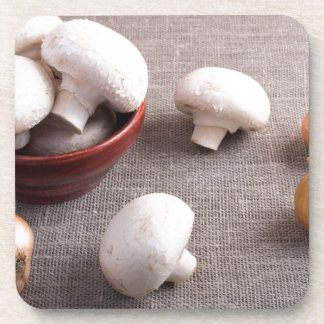 Champignon mushrooms and onions on the table beverage coasters