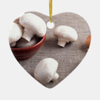 Champignon mushrooms and onions on the table ceramic heart ornament