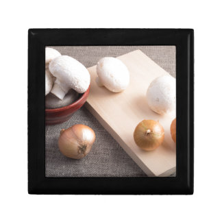 Champignon mushrooms and onions on the table gift box