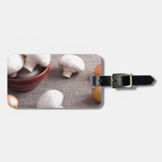 Champignon mushrooms and onions on the table luggage tag