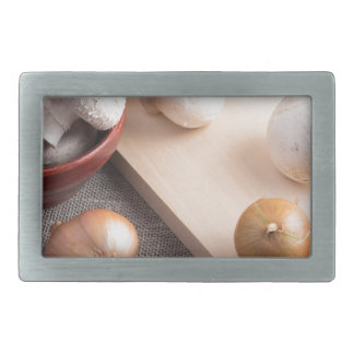 Champignon mushrooms and onions on the table rectangular belt buckle