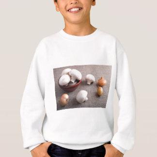 Champignon mushrooms and onions on the table sweatshirt