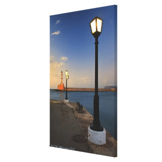 Chania Harbor and Venetian lighthouse at sunset Canvas Print