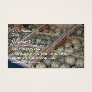 Charentais melons displayed in grocery store business card