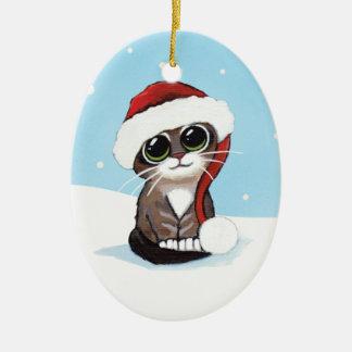 Chaton tigré de Noël dans un chapeau de Père Noël Ornement Ovale En Céramique
