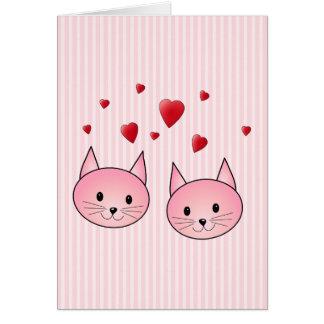 Chats roses mignons avec les coeurs rouges d amou cartes de vœux