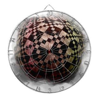 Checkered sphere dartboard with darts