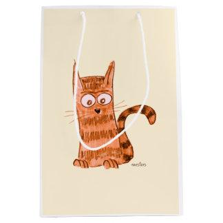 Cheerful kitten watching something we can't see medium gift bag