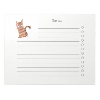 Cheerful kitten watching something we can't see notepad